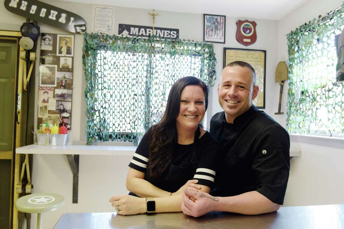 Noelle Hardy and her husband Navy veteran Shawn Hardy sits inside their restaurant, the Mess Hall, on Thursday, May 18, 2017, in Averill Park, N.Y. (Paul Buckowski / Times Union)