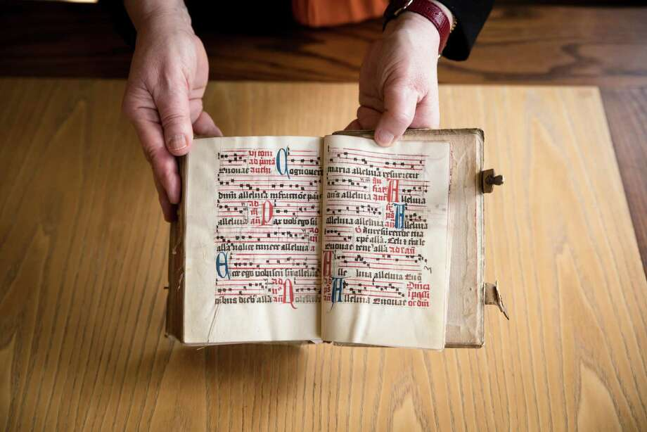 An antiphonary, a liturgical book containing psalms, hymns and prayers, dated to the 15h century, is in the special collection at the Pequot Library in the Southport section of Fairfield. Photo: Kyle Michael King / For Hearst Connecticut Media / Hearst Connecticut Media Group Freelance