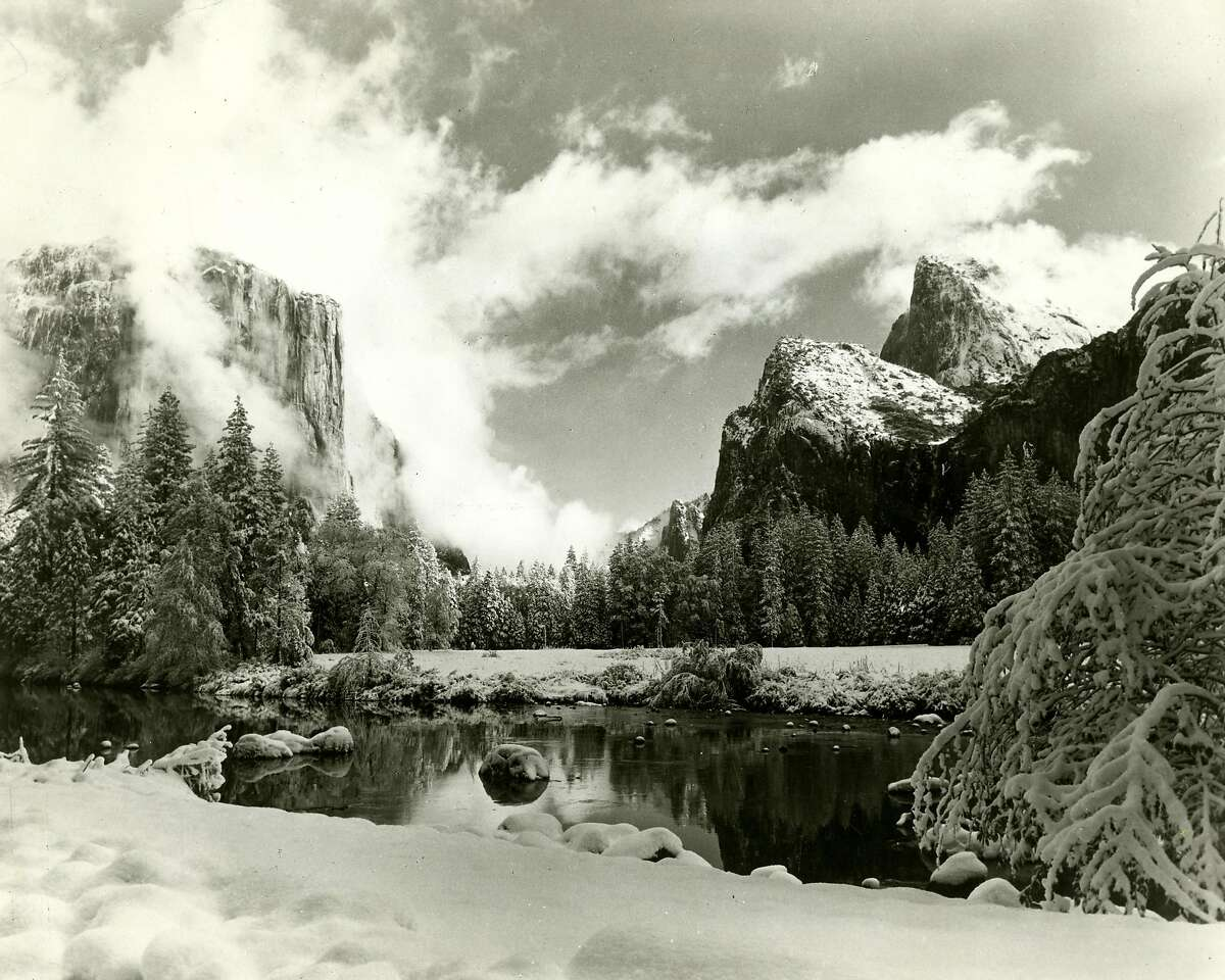 Trailing mists of snowstorm swirl over Yosemite Valley. Photo courtesy of Unite States Department of the Interior National Park Service. October 1, 1990