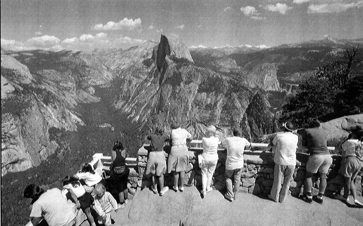 Visitors view Yosemite Valley and Little Yosemite Valley from the Glacier Point outlook in Yosemite National Park. Associated Press photo. May 10, 1989