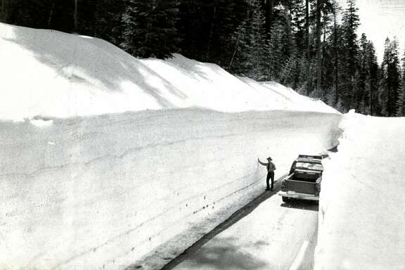 A Yosemite ranger surveys the snowpack along Tioga Pass Road in the park's high country. The record snowpack (at that time) delayed the reopening of the road at least until  mid-June. Usually the road, which was closed each winter because of snowpack, is reopened by the Memorial  Day weekend. UPI photo. May 18, 1983