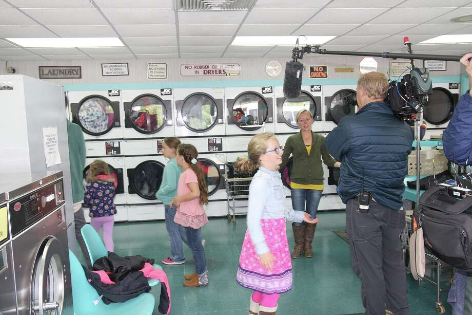 Members of the Putman family from Sand Point visit Bay Wash Coin Laundry Wednesday in Caseville. Photo: Brenda Battel/Huron Daily Tribune