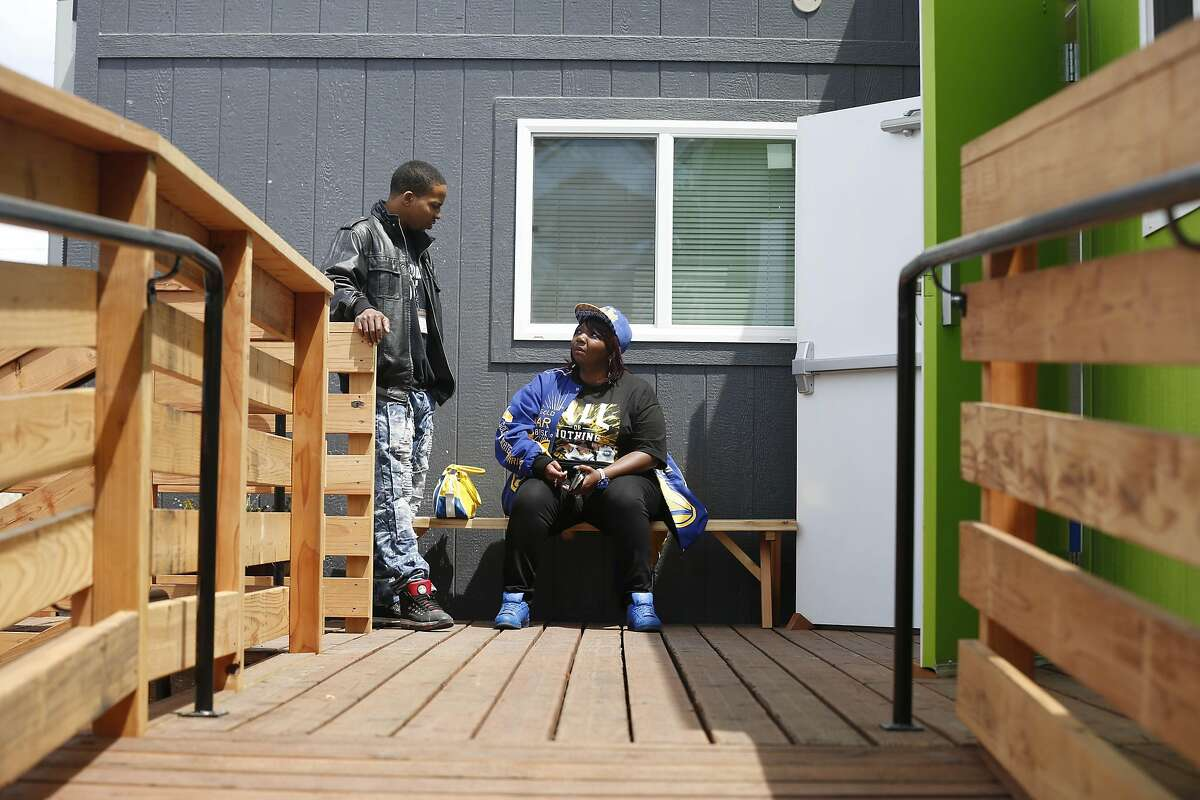 """Shucrita Jones, Providence Foundation shelter manager, talks with Kevin Smith, Providence Foundation service coordinator, near the top of a wheelchair ramp at the Dogpatch Navigation Center on Wednesday, May 23, 2017 in San Francisco, Calif. """"Wheelchairs can come on in and it wouldn't be a problem to get in,"""" said Jones, who said that the Providence Foundation shelter was an emergency overnight shelter and didn't have wheelchair ramps."""