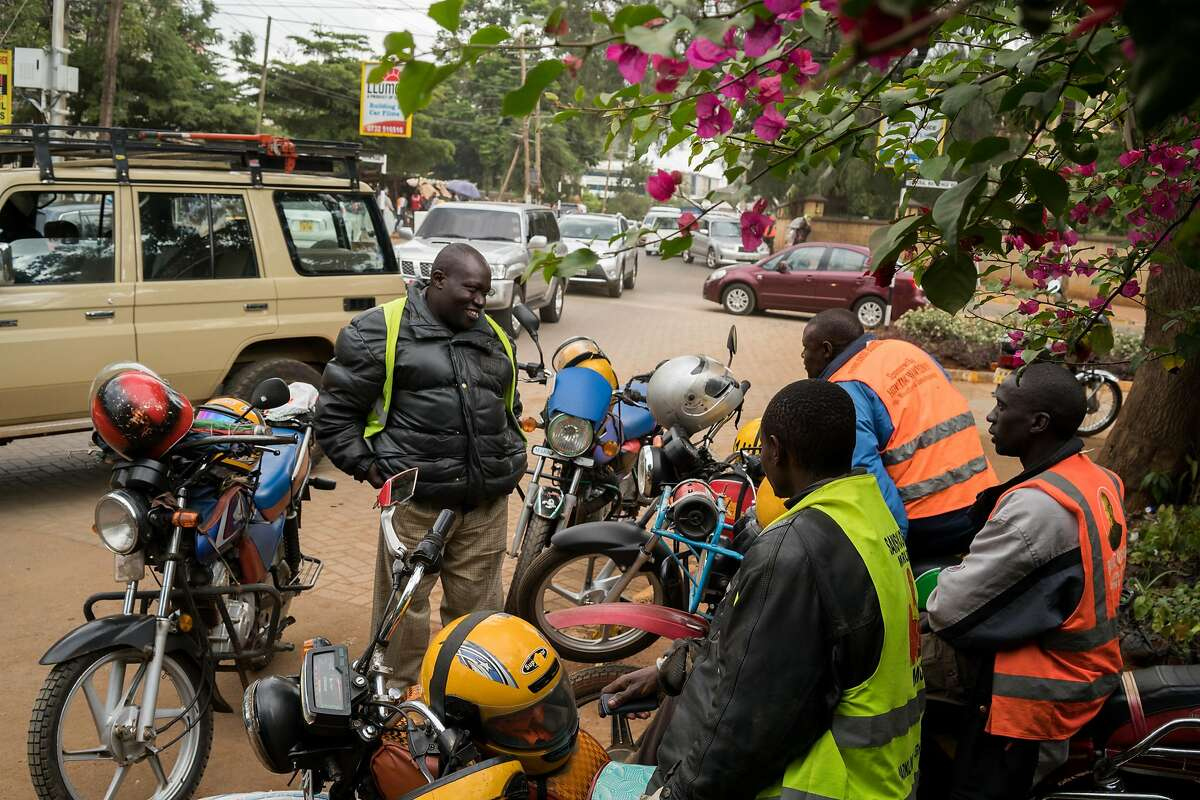 Motorcycle taxis, known as boda-bodas, in the Westlands area of Nairobi, Kenya, May 20, 2017. Uber and competitor services are engaged in a fierce price war here in Nairobi, even among apps for boda-bodas, which are notoriously dangerous and cause many accidents. (Adriane Ohanesian/The New York Times)