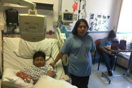 Isai Catalan, 9, is recovering from a stomach wound.
