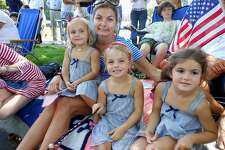 Jessica Wheeler of Fairfield and daughters Gigi, Hayes and Ellie watching the Fairfield Memorial Day parade in 2016.
