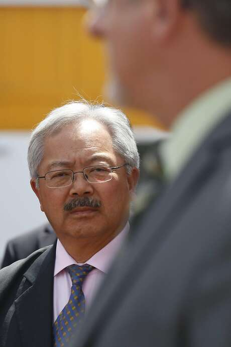 Mayor Ed Lee listens as Jeff Kositsky, Department of Homelessness & Supportive Housing director, speaks during the opening of the Dogpatch Navigation Center on Wednesday, May 23, 2017 in San Francisco, Calif. Photo: Lea Suzuki, The Chronicle
