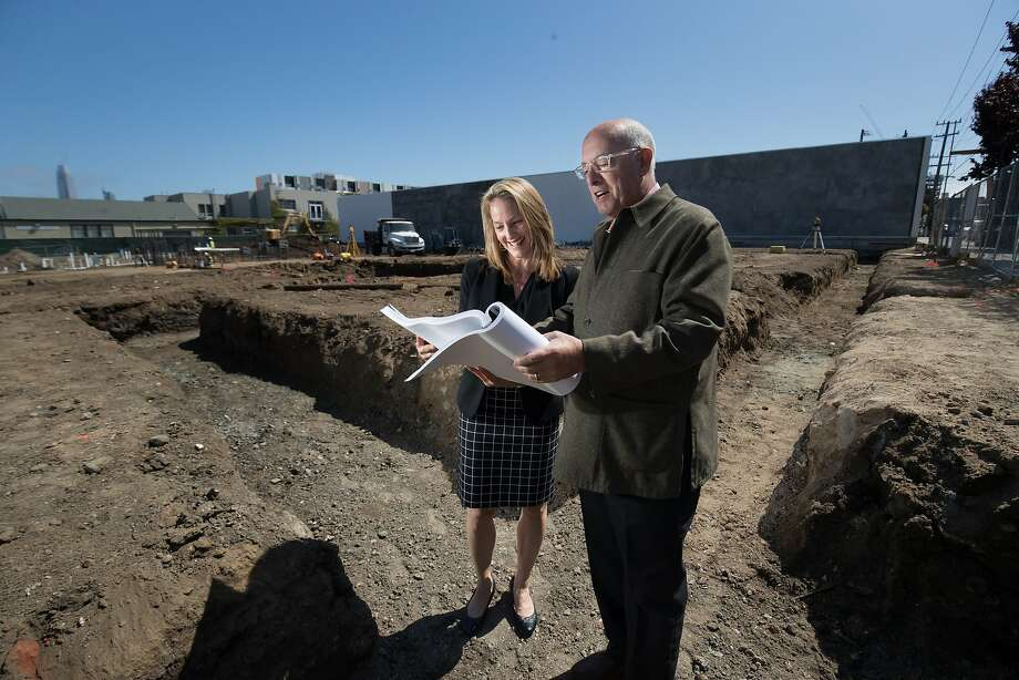 Suzanne Brown of Equity Community Builders, LLC and David Meckel of California College of the Arts look over plans on the construction site of a student housing project at 75 Arkansas St. on Tuesday, May 23, 2017 in San Francisco, CA. Photo: Paul Kuroda, Special To The Chronicle
