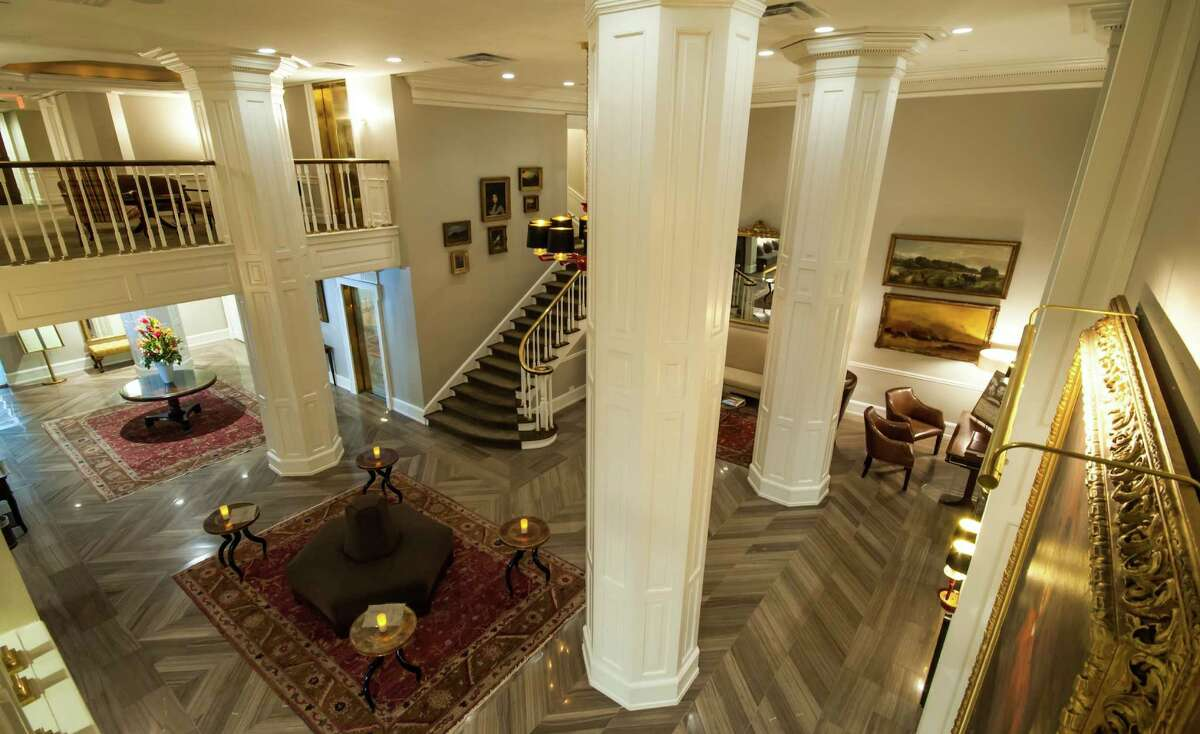 The Lancaster Hotel in downtown Houston recently completed a total redesign. Rugs and furnitire have been added to the lobby to make it more of a place to gather and relax, along with gray marble floors and a lighter color palette.