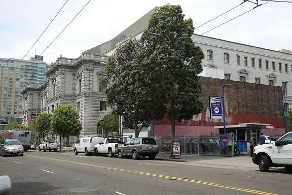 The red building is 1068 Mission St. seen next to the courthouse and before 1064 Mission Street, a leased space used as a parking lot, on Wednesday, May 24 , 2017,  in San Francisco, Calif.