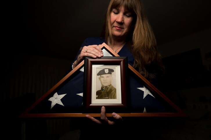 Kathy Strong holds a portrait of Specialist First Class (SFC) James Moreland in her Walnut Creek, Calif., home on Sunday, May 21, 2017. Strong has devoted years to memorializing Moreland, who died in the Vietnam War, even though the two never met.