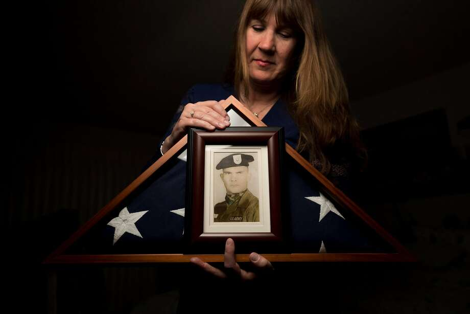 Kathy Strong displays a portrait of Army Spc. 5 James Moreland, a Green Beret who died during Vietnam's Tet Offensive in February 1968. Strong, 57, has honored the memory of Moreland since she was 12. Photo: Noah Berger, Special To The Chronicle