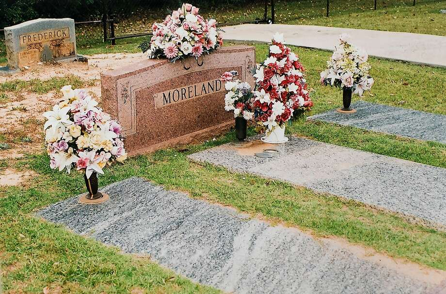 Flowers line the grave of Army Spc. James Moreland in Brierfield, Ala. Photo: Noah Berger, Special To The Chronicle