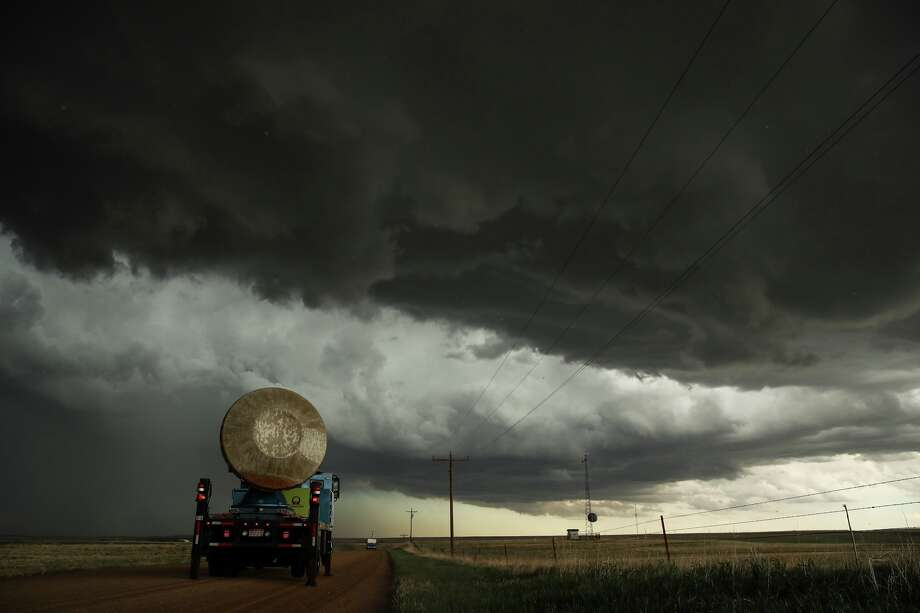The Doppler on Wheels (DOW) vehicle scans a supercell thunderstorm during a tornado research mission, May 8, 2017 in Elbert County near Agate, Colorado. Doppler on Wheels (DOW) is a mobile doppler radar mounted on a truck that brings instruments directly into storms, allowing scientists to scan storms and tornadoes and make 3-D maps of wind and debris. With funding from the National Science Foundation and other government grants, scientists and meteorologists from the Center for Severe Weather Research try to get close to supercell storms and tornadoes trying to better understand tornado structure and strength, how low-level winds affect and damage buildings, and to learn more about tornado formation and prediction. (Photo by Drew Angerer/Getty Images) Photo: Drew Angerer/Getty Images