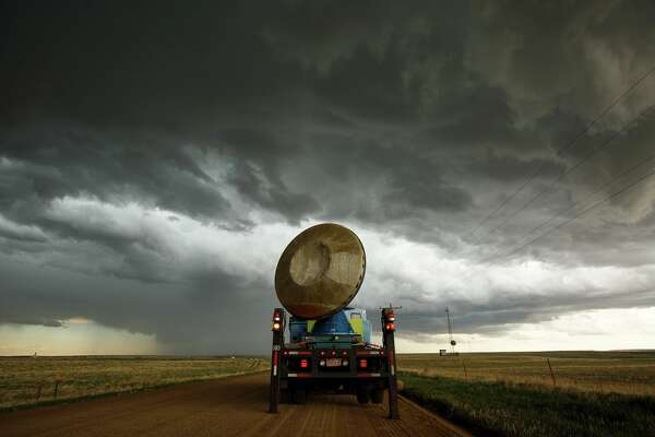 The Doppler on Wheels (DOW) vehicle scans a supercell thunderstorm during a tornado research mission, May 8, 2017 in Elbert County near Agate, Colorado. Doppler on Wheels (DOW) is a mobile doppler radar mounted on a truck that brings instruments directly into storms, allowing scientists to scan storms and tornadoes and make 3-D maps of wind and debris. With funding from the National Science Foundation and other government grants, scientists and meteorologists from the Center for Severe Weather Research try to get close to supercell storms and tornadoes trying to better understand tornado structure and strength, how low-level winds affect and damage buildings, and to learn more about tornado formation and prediction. (Photo by Drew Angerer/Getty Images)