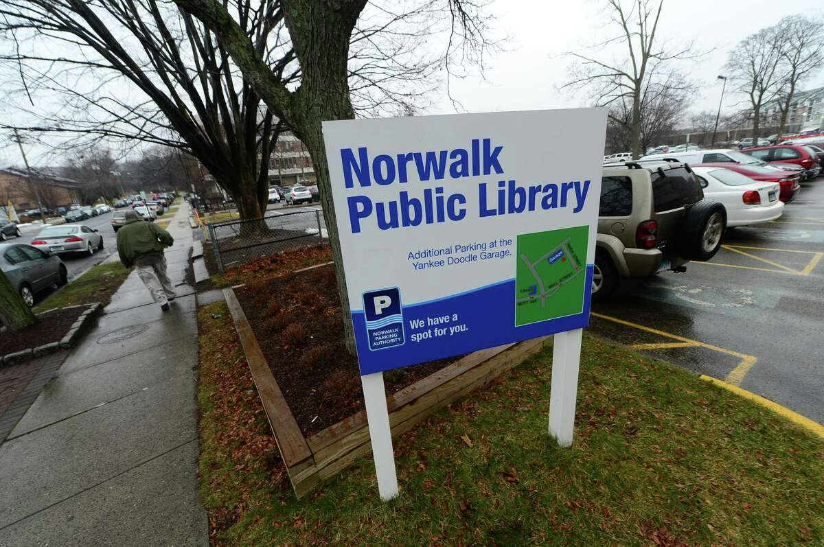 The unused parking lot next to the Norwalk Public Library Main Branch on Mott Avenue Tuesday, January 17, 2017, in Norwalk, Conn. There is an ongoing appeal of the Norwalk Zoning Commission?'s 2016 approval of a 60-unit apartment complex for the lot that had been available for library visitors.