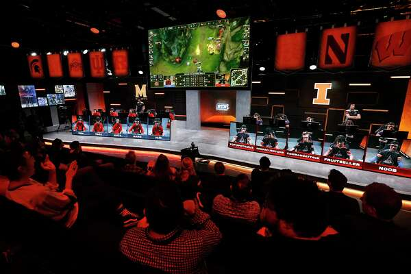 "The audience watches a match between the University of Maryland, left, and the University of Illinois in the Big Ten Network ""League of Legends"" championship in the Battle Theater at North American League Championship Arena at Riot Games on March 28, 2017 in Los Angeles. Maryland won the best of five contest by a score of 3-0. (Mel Melcon/Los Angeles Times/TNS)"