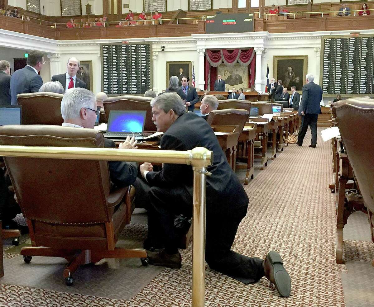 Senate Education Chairman Larry Taylor (left) confers with House Public Education Chairman Dan Huberty May 24, after the House refused to go along with the Senate's version of a school finance bill because of a provision on vouchers. The House turned down additional funding rather than use a tiny percentage of it to allow a disabled child to attend private school.