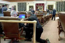 Senate Education Chairman Larry Taylor, (left) confers with House Public Education Chairman Dan Huberty on the House floor Wednesday, May 24, 2017, shortly after the House declared it would refuse to go along with the Senate's version of a key school finance bill. Taylor later said the bill would die, which leaves the state without a fix to a school funding formula the Texas Supreme Court rules last year was lawful but in dire need of improvement.