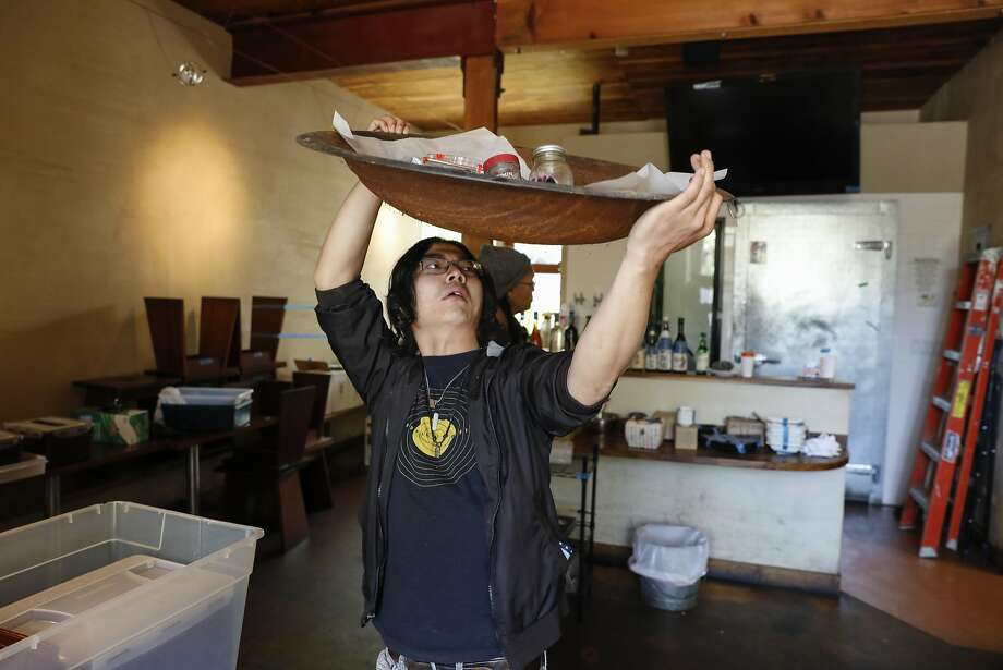 Former FuseBox senior line cook David Seo carries items to take home. Photo: Russell Yip, The Chronicle