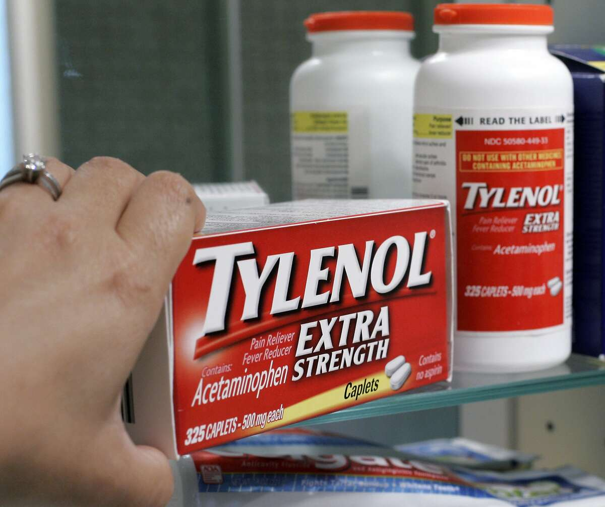 FILE - In this June 30, 2009, file photo, Tylenol Extra Strength is shown in a medicine cabinet at a home in Palo Alto, Calif. In a settlement announced Wednesday, May 24, 2017, Johnson & Johnson reached a $33 million settlement with 42 states, resolving allegations the health care giant sold numerous nonprescription medicines that didn't meet federal quality requirements for a couple of years. The case dates to 2009, when Johnson & Johnson began dozens of voluntary recalls of popular over-the-counter medicines for children and adults, including Tylenol, Motrin and Benadryl. (AP Photo/Paul Sakuma, file)