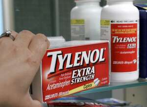 FILE - In this June 30, 2009, file photo, Tylenol Extra Strength is shown in a medicine cabinet at a home in Palo Alto, Calif. In a settlement announced Wednesday, May 24, 2017, Johnson & Johnson  reached a $33 million settlement with 42 states, resolving allegations the health care giant sold numerous nonprescription medicines that didn�t meet federal quality requirements for a couple of years. The case dates to 2009, when Johnson & Johnson began dozens of voluntary recalls of popular over-the-counter medicines for children and adults, including Tylenol, Motrin and Benadryl. (AP Photo/Paul Sakuma, file)