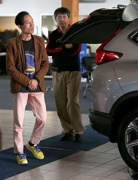 Customers look at a 2017 Honda CRV EXL all-wheel-drive with Honda Sensing at the dealership in Oakland. This year, 38 percent of Honda cars have included the Honda Sensing technology. Photo: Liz Hafalia, The Chronicle