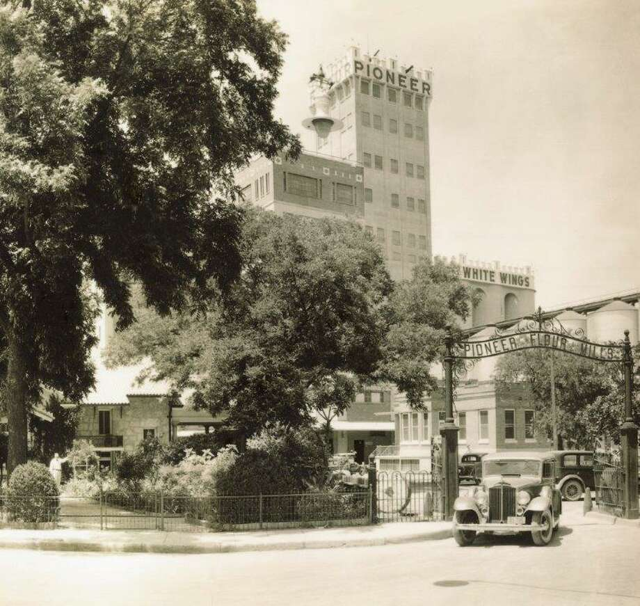 The Pioneer Flour Mills grain tower and original signage are seen in this 1936 photo. Photo: Reprinted By Permission Of C.H. Guenther & Son, Inc.