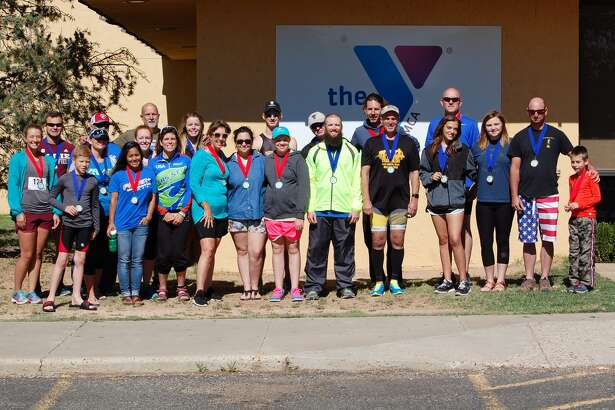 A number of competitors were age-group winners at the Plainview YMCA's Armed Forces Day Triathlon Saturday. Not pictured are Regan Manning, Daniel Schantin and Rick Shaw.