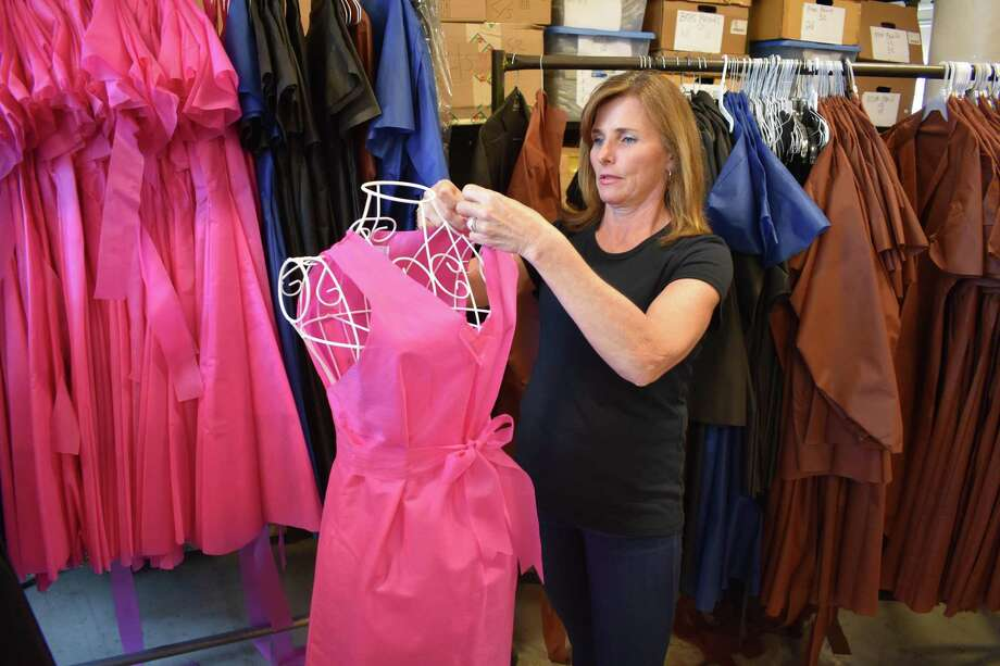 Wear & Away founder Laurie Tuck on May 17, 2017, at the Bridgeport, Conn. facility she is using to produce and sell a line of throw-on robes and clothing that resists staining from spray-on tan treatments. Photo: Alexander Soule / Hearst Connecticut Media / Stamford Advocate