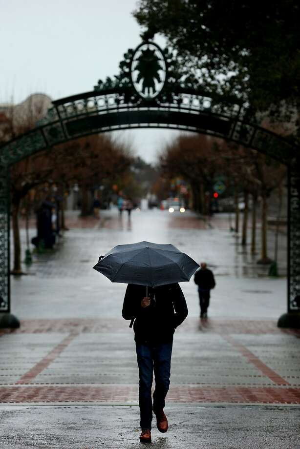 A UC Berkeley student walks past Sather Gate in January, the month UC regents voted to raise tuition after throwing an expensive dinner party for themselves. Photo: Santiago Mejia, The Chronicle