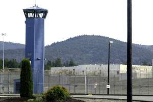 FILE - In this Dec. 7, 2001 file photo, Pelican Bay State Prison is seen outside of Crescent City, Calif. Officials say several California prison guards and inmates were taken to hospitals after a fight between two inmates quickly raged out of control Wednesday, May 24, 2017. (AP Photo/Rich Pedroncelli, File)