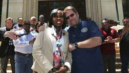 San Antonio Police Officers Association President Mike Helle (right, foreground) embraces San Antonio mayor Ivy Taylor Wednesday May 24, 2017 in front of city hall after announcing the association's support for Taylor as a mayoral candiddate.