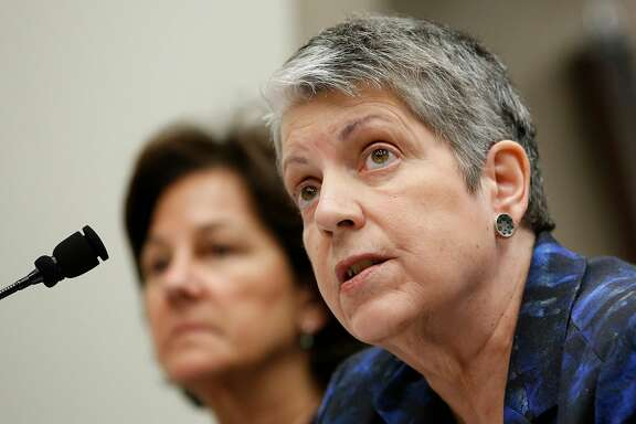 FILE - In this Tuesday, May 2, 2017, file photo, Janet Napolitano, right, responds to a question, as Monica Lozano, chair of the UC Board of Regents, left, looks on while appearing before a Joint Legislative Audit Committee in Sacramento, Calif. State Auditor Elaine Howle is expected to brief the UC Regents Thursday, May 18, 2017, on findings that UC administrators hid $175 million in a secret reserve fund and that the president�s office interfered with the audit process. Napolitano denied her office improperly stashed money. (AP Photo/Rich Pedroncelli, File)