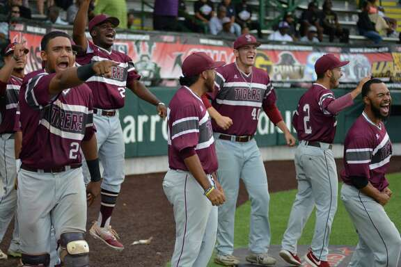 TSU players celebrate after Gerrick Jimenez's go-ahead hit during the 13th inning of the SWAC tournament championship game against Alabama State.