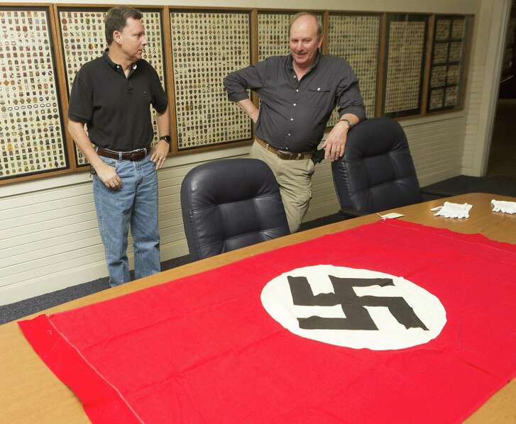 Charles Bickle Jr. (left) shares memories of his father, Charles Bickle Sr. and the Nazi flag he brought home from serving in WWII.