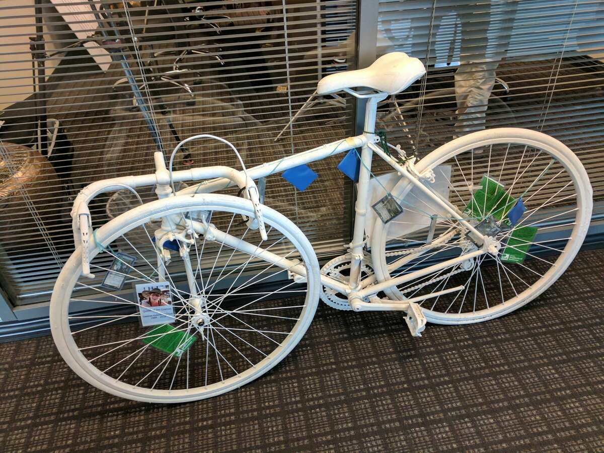 Desiree McCloud's bicycle, painted white, sat in the Campiche Arnold law offices Wednesday morning. It's a common practice in the bicycle community to paint a traffic victim's bike white as a memorial to the rider.