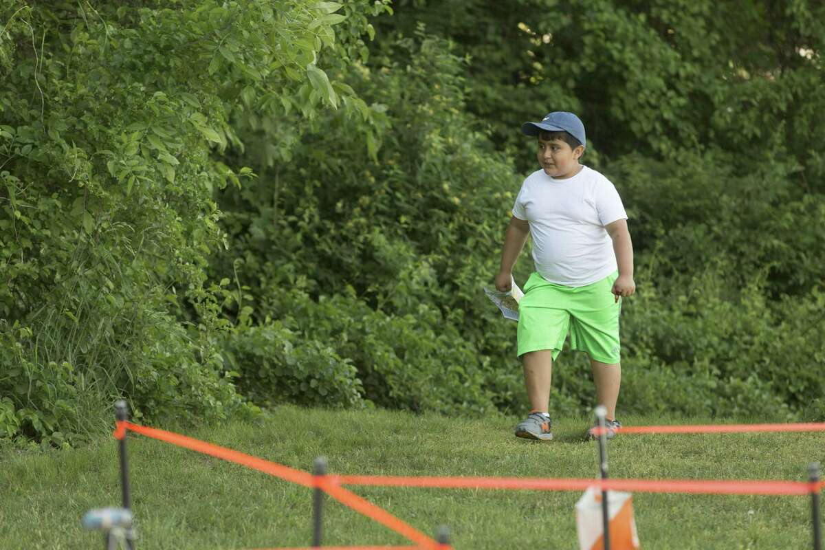 Aaron Portillo, 8 of Bethel, navigates during a World Orienteering Day celebration sponsored by the Western Connecticut Orienteering Club at Rockwell School in Bethel, Conn. on Wednesday, May 24.