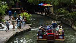 A boat tour guide with Rio San Antonio Cruises drives his group down the San Antonio River in downtown San Antonio on June 10, 2016. The City Council is expected to select a new company to operate the barges Thursday.