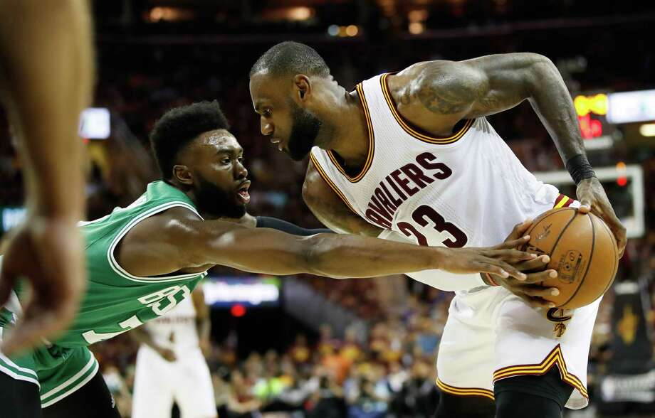CLEVELAND, OH - MAY 23:  LeBron James #23 of the Cleveland Cavaliers controls the ball against Jaylen Brown #7 of the Boston Celtics in the fourth quarter during Game Four of the 2017 NBA Eastern Conference Finals at Quicken Loans Arena on May 23, 2017 in Cleveland, Ohio. NOTE TO USER: User expressly acknowledges and agrees that, by downloading and or using this photograph, User is consenting to the terms and conditions of the Getty Images License Agreement.  (Photo by Gregory Shamus/Getty Images) ORG XMIT: 700050324 Photo: Gregory Shamus / 2017 Getty Images