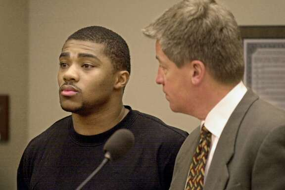 Michael Bennett, former Wisconsin running back, appears for a bail hearing  with his attorny Stephen P. Hurley, right, Monday, Feb. 12, 2001, in a Dane County Court on felony charges for intimidating a victim. (AP Photo/Andy Manis).     HOUCHRON CAPTION (04/08/2001):  Bennett.  HOUSTON CHRONICLE SERIES: NFL DRAFT 2001.