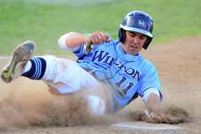 Willton's Collin Kahal reaches home plate to score a run during FCIAC baseball semi-finals action against Darien at the Ballpark at Harbor Yard in Bridgeport, Conn., on Wednesday May 24, 2017.