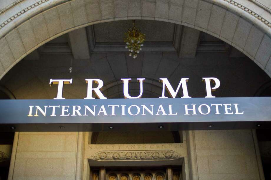 FILE - This Monday, Sept. 12, 2016, file photo, shows the exterior of the Trump International Hotel in downtown Washington. The Trump Organization says it will not ask guests at its hotels and resorts if they are using money from foreign governments to pay their bills, setting up a possible showdown with Democrats who accuse the president of violating the U.S. Constitution. (AP Photo/Pablo Martinez Monsivais, File) Photo: Pablo Martinez Monsivais, STF / Associated Press WashDC