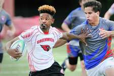 Zhaire House of Greenwich with the ball stiff-arms a Fairfield Co-op defender during the state semi-final boys high school rugby match between Greenwich High School and Fairfield Co-Op at Greenwich High School, Greenwich, Conn., Wednesday May 24, 2017.