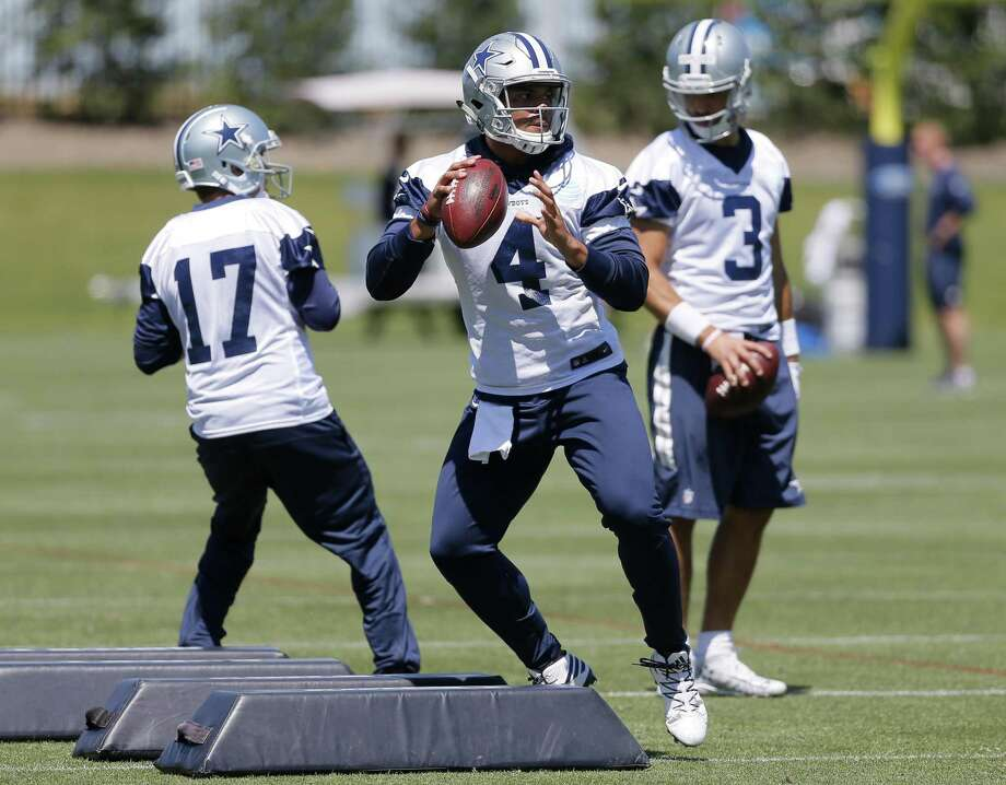 Dallas Cowboys quarterbacks Dak Prescott (4), Kellen Moore (17) and Austin Appleby (3) run through drills during organized team activities at the team's training facility on May 24, 2017, in Frisco. Photo: Tony Gutierrez /Associated Press / Copyright 2017 The Associated Press. All rights reserved.