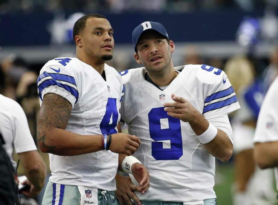 Dallas Cowboys' Dak Prescott (4) and Tony Romo talk on the sideline in the first half against the Baltimore Ravens on Nov. 20, 2016, in Arlington. Photo: Michael Ainsworth /Associated Press / Stratford Booster Club