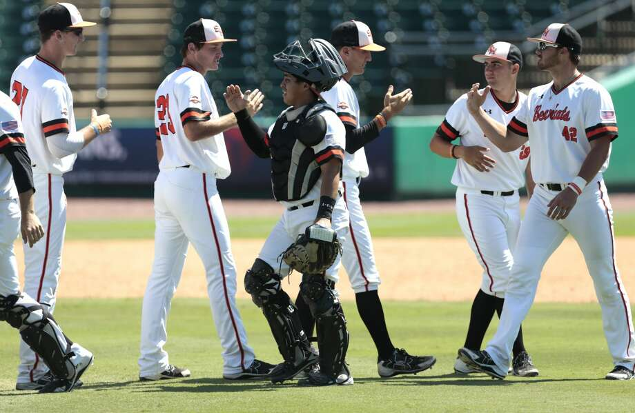 Sam Houston State players high five after beating Stephen F. Austin during the first round of the Southland Conference baseball tournament at Constellation Field on Wednesday, May 24, 2017, in Sugar Land. ( Brett Coomer / Houston Chronicle ) Photo: Brett Coomer/Houston Chronicle