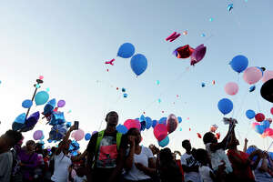 Attendees release pink and blue balloons during a vigil at West Brook High School Wednesday evening for Jordan Brown, 16, and sister Jadyn Brown, 10, who were killed in a car wreck last Friday.  Photo taken Wednesday 5/24/17 Ryan Pelham/The Enterprise