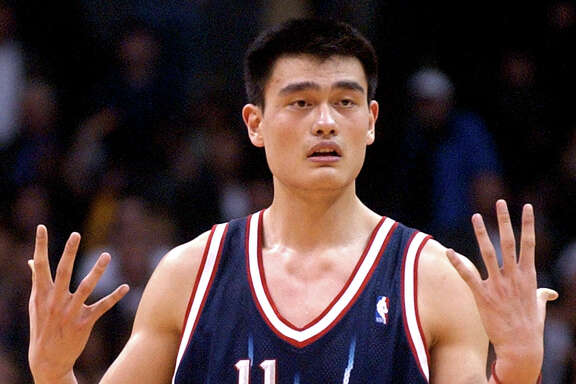 Houston Rockets' Yao Ming protests to a referee after fouling out during the first overtime of the Rockets' 106-99 double overtime loss to the Los Angeles Lakers at Staples Center in Los Angeles, Tuesday, Feb. 18, 2003. (AP Photo/Chris Pizzello)