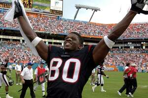 Texans wide receiver and Miami native Andre Johnson celebrates the final seconds of the team's upset win over the Dolphins in Miami Sunday afternoon.  Johnson had the special distinction of having 140& family members attending the game.    9/7/03  (Karl Stolleis/Houston Chronicle)  HOUCHRON CAPTION  (09/08/2003):  Texans wide receiver and Miami native Andre Johnson savors the moment after the Texans defeated the Dolphins 21-20 Sunday at Pro Player Stadium in Miami.     HOUCHRON CAPTION (09/12/2004):  MIAMI NICE:  Andre Johnson, a Miami native, celebrated the Texans' win over the Dolphins in last season's opener.